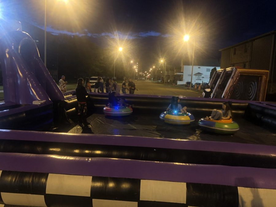 Students ride on bumper cars on 3rd Street
