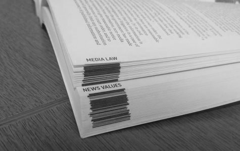 A peek into the AP Stylebook, featuring the sections on Media Law and News Values.